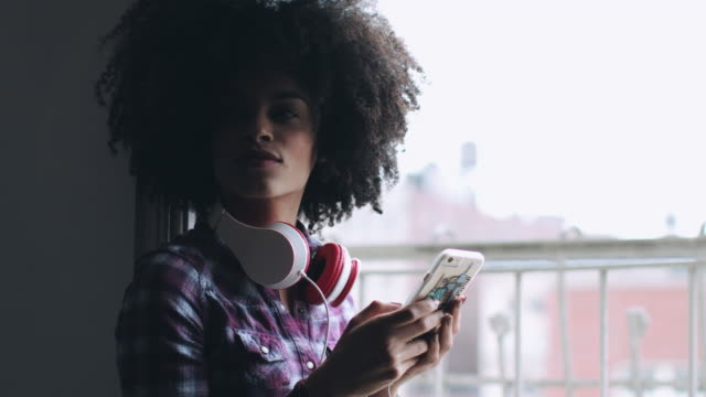 Afro American Female with smart phone