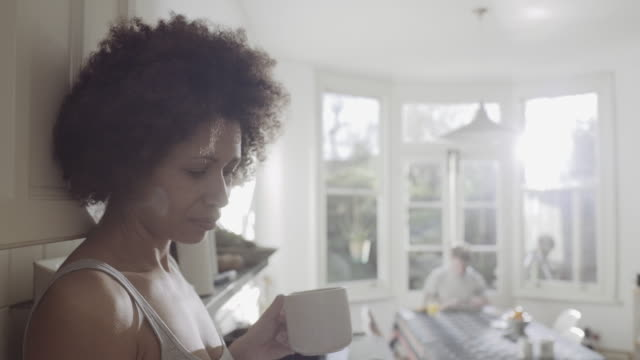 afro american woman in kitchen enjoying coffee in the morning - 20 seconds or greater stock videos & royalty-free footage