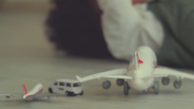afro baby with toy airplane at home - imagination stock videos & royalty-free footage