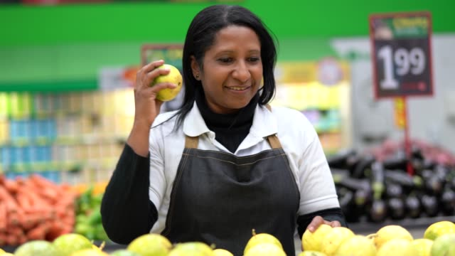 afro brazilian woman employee picking the right passion fruit - america del sud video stock e b–roll