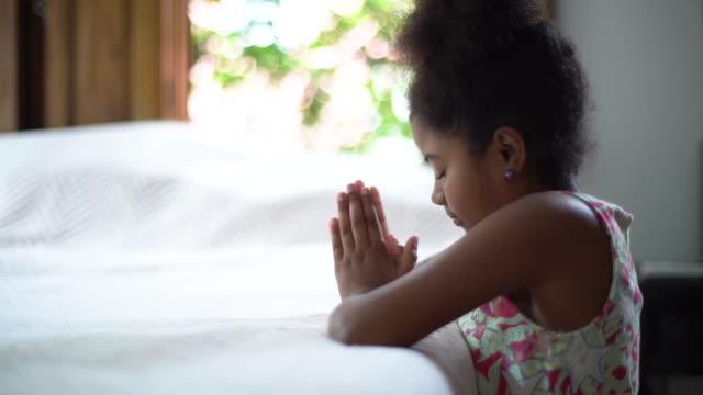 afro child praying at home - kneeling stock videos & royalty-free footage