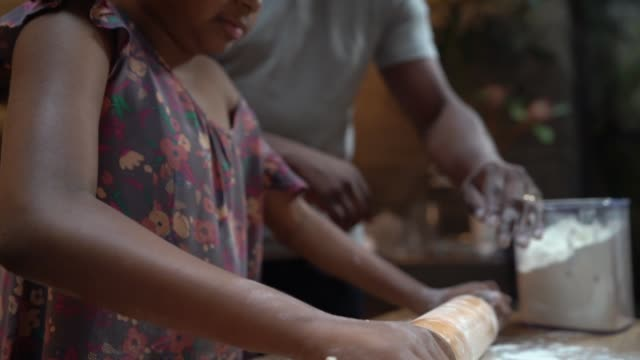 afro father teaching his daughter how to cook at home - rolling pin stock videos & royalty-free footage