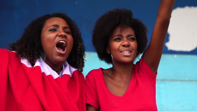 afro friends watching a soccer game - afro stock videos & royalty-free footage