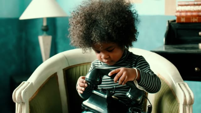 afro girl using vintage phone - 2 3 years stock videos & royalty-free footage