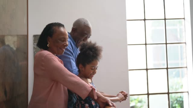 afro hispanic latino grandparents and granddaughter portrait at home - i love you stock videos & royalty-free footage