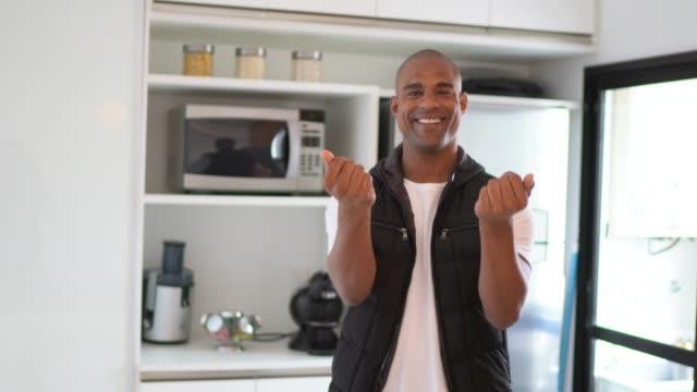 afro hispanic latino man beckoning at home - beckoning stock videos & royalty-free footage