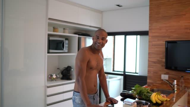 afro hispanic latino man portrait at home - pardo brazilian stock videos & royalty-free footage