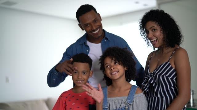 afro latin family beckoning at home - beckoning stock videos & royalty-free footage
