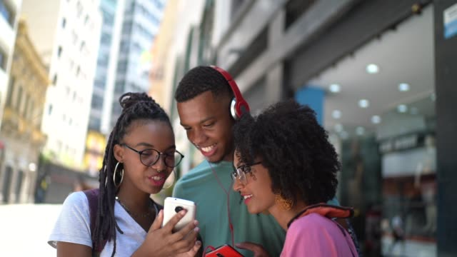 Afro latin friends looking for a viral video on mobile