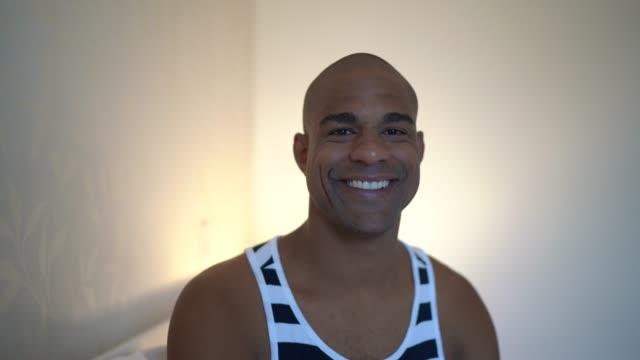 afro latin man portrait at bed - pardo brazilian stock videos & royalty-free footage