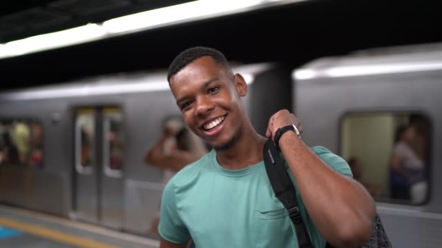 afro latin young man portrait at metro station - passenger train stock videos & royalty-free footage