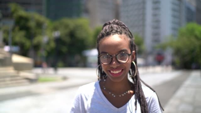 afro latin young woman in the city portrait - eyewear stock videos & royalty-free footage