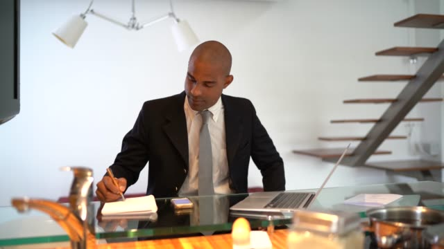 afro latino businessman working on a laptop at home office - to do list stock videos & royalty-free footage