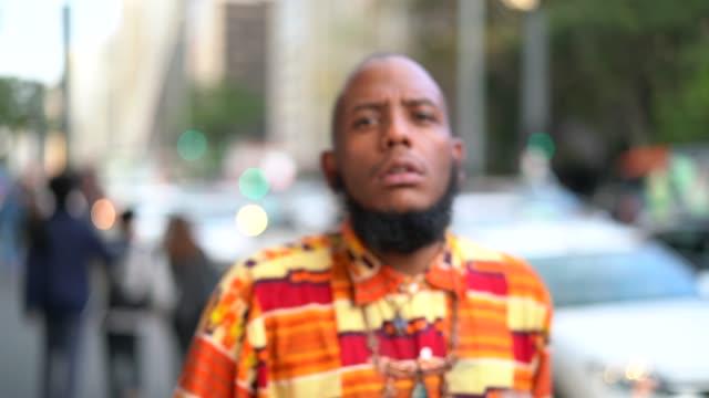 Afro serious descent rapper making a rap