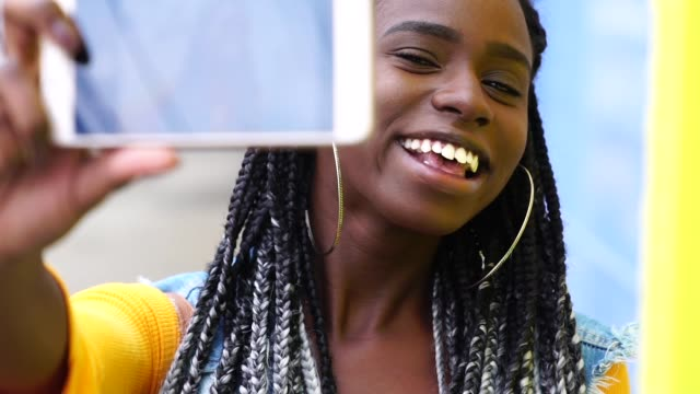 afro woman taking a selfie - trinidad trinidad and tobago stock videos & royalty-free footage