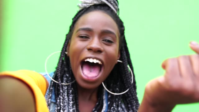 afro woman taking a selfie - gesturing stock videos and b-roll footage