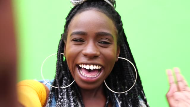 afro woman taking a selfie - caribbean stock videos & royalty-free footage