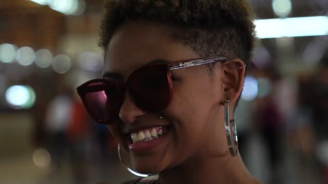afro young woman portrait at metro station - sunglasses stock videos & royalty-free footage