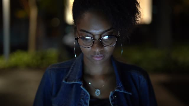 afro young woman portrait in the city at night - facial expression stock videos & royalty-free footage