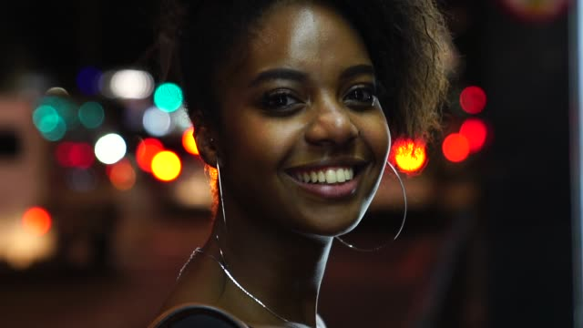 afro young woman portrait in the city at night - puerto rico stock videos & royalty-free footage