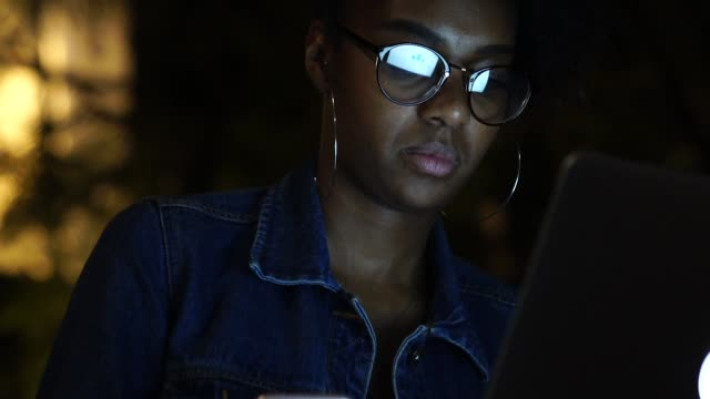 afro young woman working in her laptop - pardo brazilian stock videos & royalty-free footage