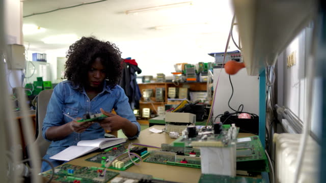 afro-american female technician at work - electrical equipment stock videos & royalty-free footage
