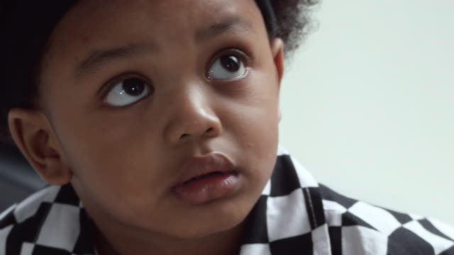 afro-american kid looking up and thinking - babies only stock videos & royalty-free footage