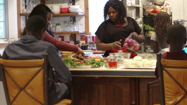 afro-american large family thanksgiving dinner home - thanksgiving stock videos & royalty-free footage
