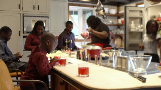 afro-american large family thanksgiving dinner home - meal stock videos & royalty-free footage