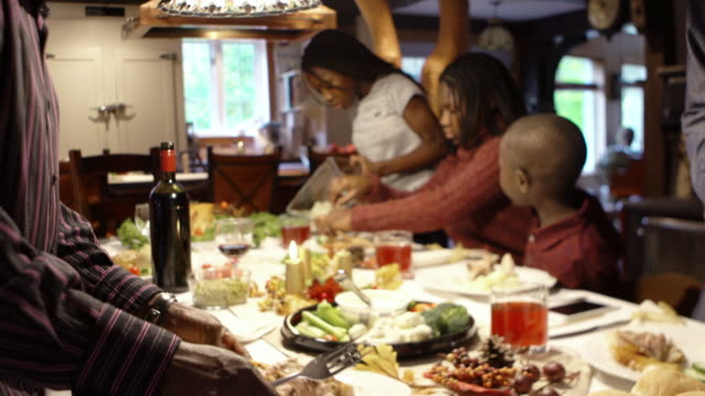 afro-american large family thanksgiving dinner home - domestic kitchen stock videos & royalty-free footage