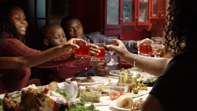 afro-american large family thanksgiving dinner home - african american ethnicity stock videos & royalty-free footage