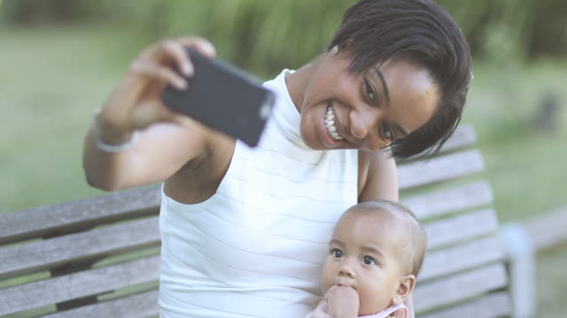 afro-american mother and baby taking selfie - two generation family stock videos & royalty-free footage