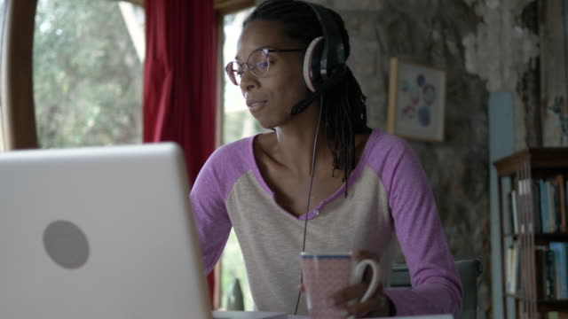afro-caribbean woman working from home during the covid lockdown - remote location stock videos & royalty-free footage
