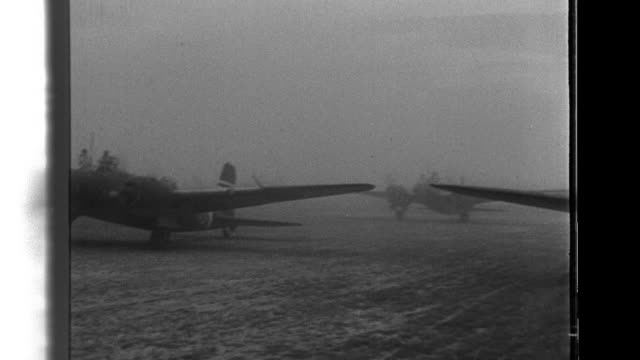 after a discussion of their mission at an airfield imperial japanese army air corps bomber crews take off and fly in formation on their way to... - airfield stock videos & royalty-free footage