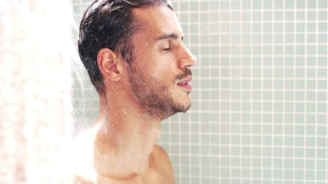 after a long day, a shower feels great - bathroom stock videos & royalty-free footage