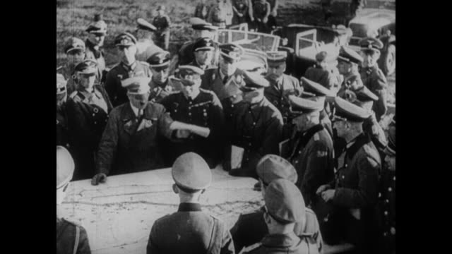 stockvideo's en b-roll-footage met after a look at the material wealth of czechoslovakia, the alliances between britain, france and czechoslovakia are brought into play as hitler... - nazism
