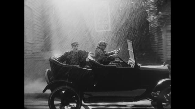 1928 after a man (buster keaton) jumps out of a moving car, he is brought to the hospital - 1928 stock-videos und b-roll-filmmaterial