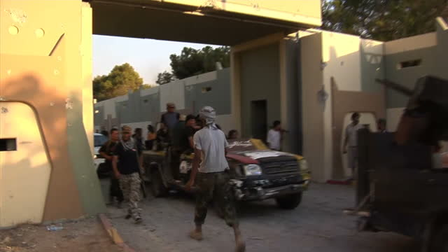 after a momentous day which saw rebels storm colonel gaddafi's power base in tripoli the question this morning is where is he last night thousands of... - libya stock videos & royalty-free footage