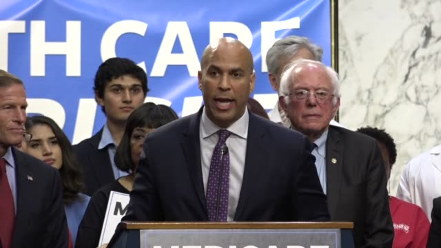 vídeos de stock, filmes e b-roll de after a news conference led by senator bernie sanders and others concluded a supporter is seen holding up a cutout of california senator dianne... - bernie sanders