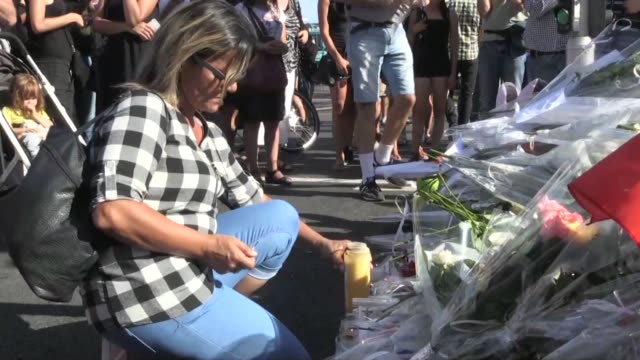 after a night of little sleep and many tears the people of nice struggle to come to terms with an attack that left 84 people dead - terrorism stock videos & royalty-free footage