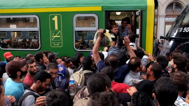 after a twoday lockout from keleti train station in central budapest refugees rush to board trains they hope will bring them closer to germany... - flüchtling stock-videos und b-roll-filmmaterial