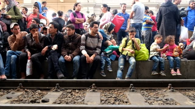 after a twoday lockout from keleti train station in central budapest refugees wait on the platforms for trains they hope will take them to germany - refugee stock videos & royalty-free footage