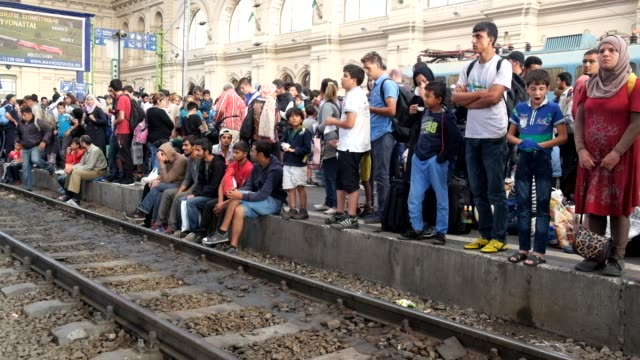 After a twoday lockout from Keleti train station in central Budapest refugees wait on the platforms for trains they hope will take them to Germany