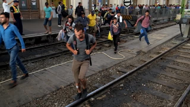 after a two-day lockout from keleti train station in central budapest, refugees rush to board trains they hope will bring them closer to germany.... - budapest stock-videos und b-roll-filmmaterial
