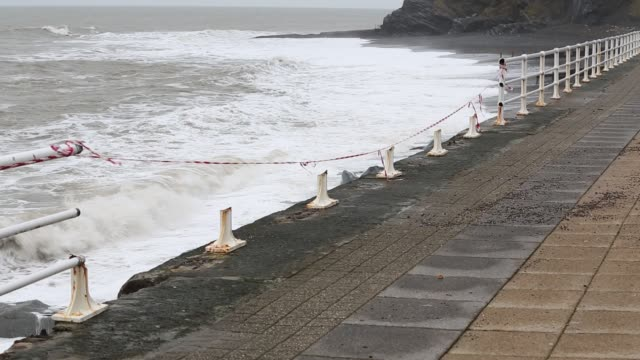 vídeos de stock e filmes b-roll de after a week of high tides, storm surges and storm force winds, the sea front promenade of aberystwyth in wales has been devastated, with millions of £'s of damage. - aberystwyth