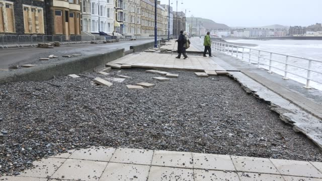 after a week of high tides, storm surges and storm force winds, the sea front promenade of aberystwyth in wales has been devastated, with millions of... - aberystwyth stock videos & royalty-free footage