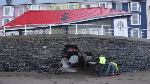 after a week of high tides storm surges and storm force winds the sea front promenade of aberystwyth in wales has been devastated with millions of... - atlantic ocean stock videos & royalty-free footage