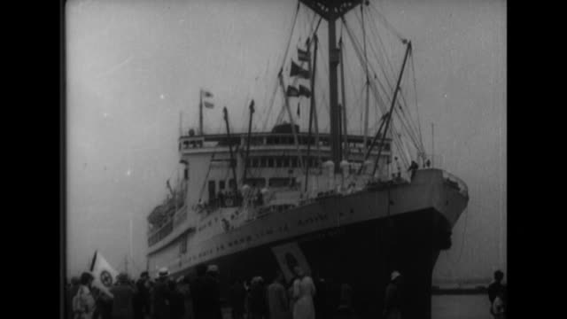 after ambassador shigemitsu arrives on the kamakura maru he gives an interview at the bottom of the gangway and then departs in a limousine - fluggastbrücke stock-videos und b-roll-filmmaterial