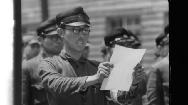 vídeos de stock e filmes b-roll de after an imperial japanese navy officer gives instructions to mobilized students at the navyís arms factory, a student representative affirms their dedication; the students work in the torpedo factory. - 1944