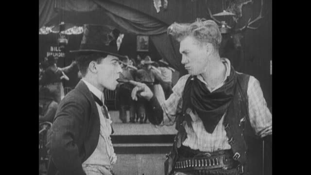 1918 after being pushed by wild bill hiccup, man (buster keaton) coughs up a cigar - hiccup stock videos and b-roll footage